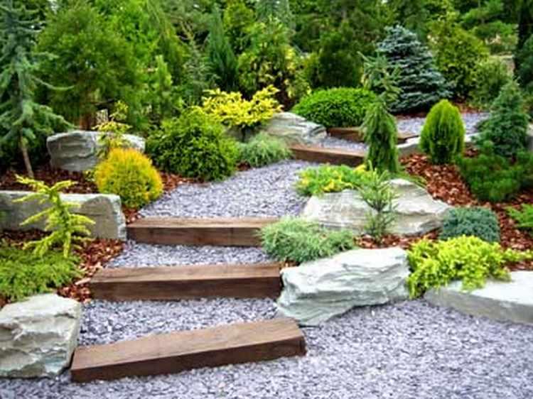 Jardines peque os con encanto dise os y decoracion - Macetas de piedra para jardin ...